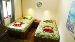 A bed or beds in a room at Cabinas Montesol