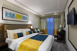 A bed or beds in a room at Belmont Hotel Boracay