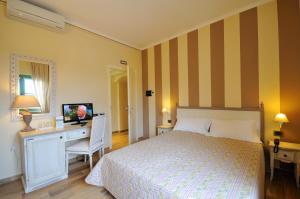 Letto o letti in una camera di Hotel Dei Conti