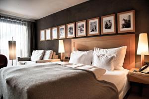 Ein Bett oder Betten in einem Zimmer der Unterkunft Hotel Madlein