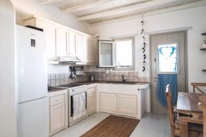 A kitchen or kitchenette at Traditional Paros House