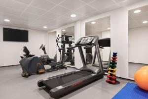 The fitness center and/or fitness facilities at Ramada by Wyndham Cobham