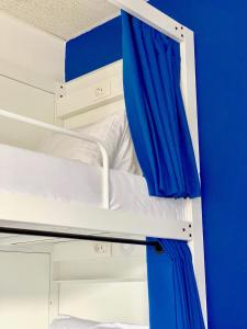 A bunk bed or bunk beds in a room at Primestay Apartmenthaus Zürich Seebach