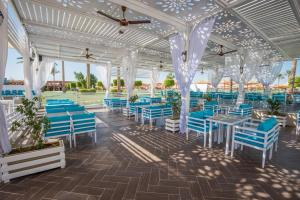 مطعم أو مكان آخر لتناول الطعام في Sunrise Royal Makadi Resort