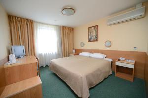 Кровать или кровати в номере Домодедово Аэротель