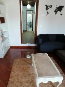 Uma área de estar em Casa Da Zu