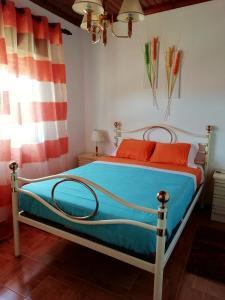 Uma cama ou camas num quarto em Casa Da Zu