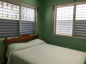 A bed or beds in a room at Lydia's Guesthouse