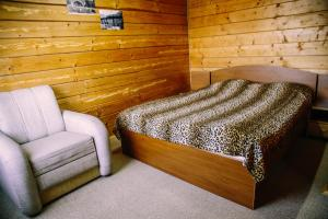 A bed or beds in a room at Vuyko
