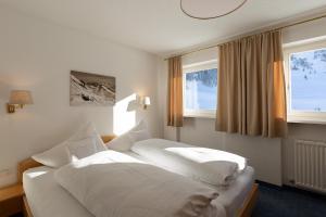 Ein Bett oder Betten in einem Zimmer der Unterkunft Chalet Schneekristall