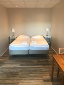 A bed or beds in a room at Við Hafið Guesthouse