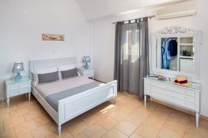 Ένα ή περισσότερα κρεβάτια σε δωμάτιο στο Ξενοδοχείο Ακρωτήρι