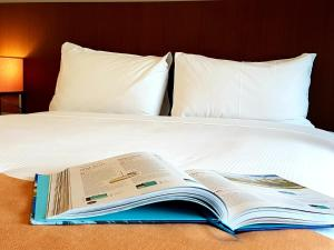 A bed or beds in a room at ibis Brisbane Airport