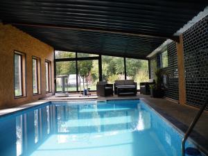 The swimming pool at or near Gîte Lorengrain