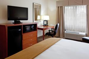 A television and/or entertainment center at Holiday Inn Express & Suites - Hardeeville-Hilton Head, an IHG Hotel