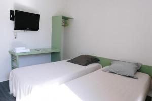 A bed or beds in a room at FastHotel Castres