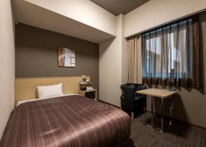 호텔 루트 인 그랜드 아사히카와 에키마에 객실 침대