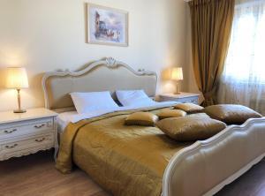 Кровать или кровати в номере Волга Апарт-Отель