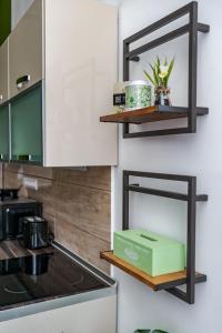 Kuchyň nebo kuchyňský kout v ubytování Central Kira Apartment