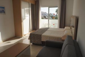 Letto o letti in una camera di Apartamentos El Sombrero