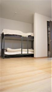 A bunk bed or bunk beds in a room at Sadie's Home