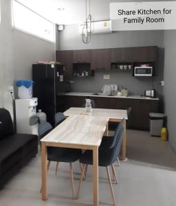 A kitchen or kitchenette at Chiangmai Gate Capsule Hostel Dormitory