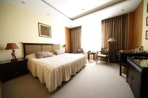 Кровать или кровати в номере Отель Атлаза Сити Резиденс