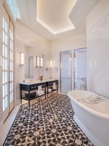 A bathroom at Raffles Singapore