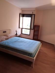 Säng eller sängar i ett rum på Palma 54