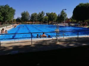 The swimming pool at or near albergue rural vía de la plata