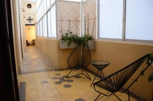 A balcony or terrace at Sabatico Travelers Hostel & Guesthouse