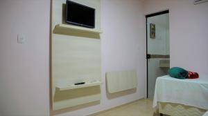 A television and/or entertainment centre at Espaço Costa Verde