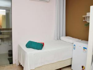 A bed or beds in a room at Espaço Costa Verde