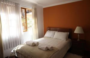 Cama o camas de una habitación en Casa Los Jazmines