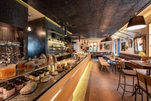 Ein Restaurant oder anderes Speiselokal in der Unterkunft Nala Individuellhotel