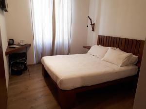 A bed or beds in a room at Art Guest House