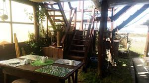A restaurant or other place to eat at El jardin de Eli