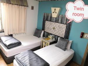 A bed or beds in a room at Athene Motel