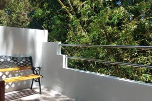 A balcony or terrace at 2 Story Smart Home with Balcony near Dumaguete Airport
