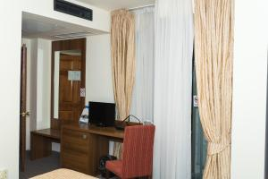 A television and/or entertainment center at Hotel Burgas