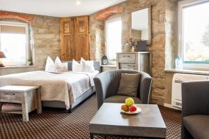 """Ein Bett oder Betten in einem Zimmer der Unterkunft """"Alte Pension"""" Bautzen"""
