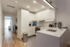 A kitchen or kitchenette at Blue&Greens Apartment