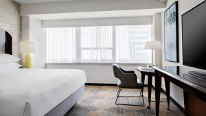 A bed or beds in a room at Sheraton Dallas Hotel
