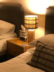 A bed or beds in a room at Ardconnel Bed and Breakfast