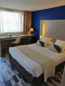 Un ou plusieurs lits dans un hébergement de l'établissement Kyriad Carcassonne - Aéroport