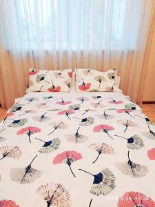 A bed or beds in a room at Отель Home