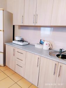 A kitchen or kitchenette at Отель Home