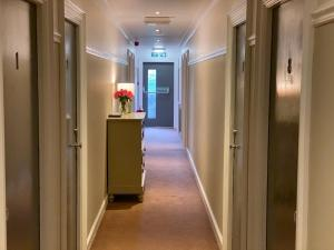 The lobby or reception area at Auld Mill House Hotel