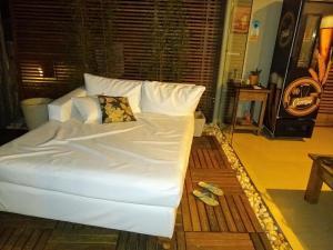 Cama ou camas em um quarto em Casarão da Ferradura B&B