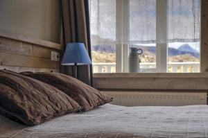 Ein Bett oder Betten in einem Zimmer der Unterkunft Hraunsnef Country Hotel